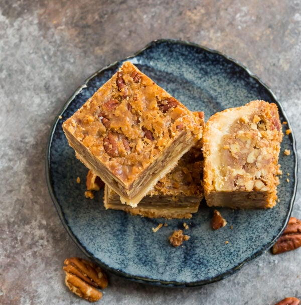 Best ever pecan pie bars with no corn syrup served on a plate
