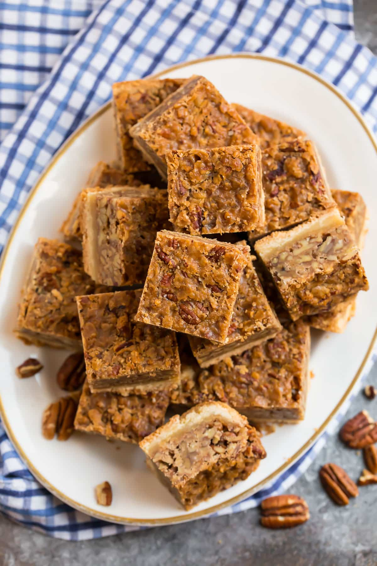 A plate of easy pecan pie bars with no corn syrup