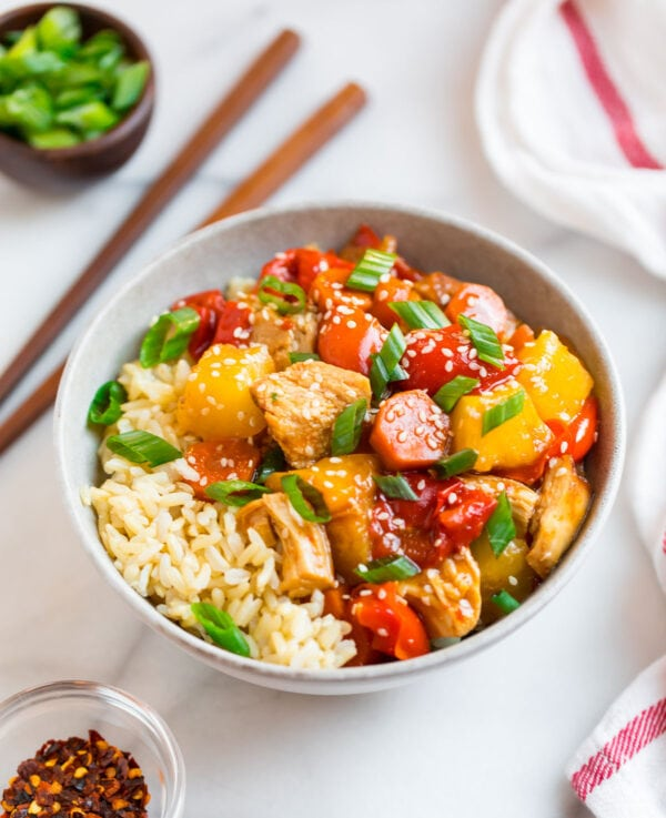 A bowl of delicious and easy crockpot sweet and sour chicken with pineapple juice