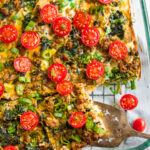 Easy Homemade Whole30 Breakfast Casserole with sausage, spinach, eggs, and tomatoes in a serving dish