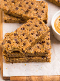 a stack of Vegan Protein Bars made with oats, dates, and peanut butter with chocolate chips