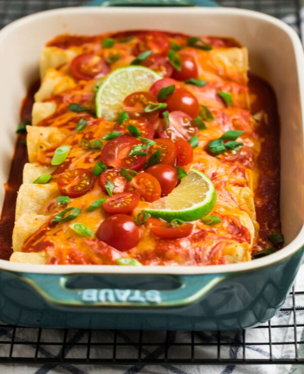 Delicious and easy Instant Pot chicken enchiladas in a blue casserole dish