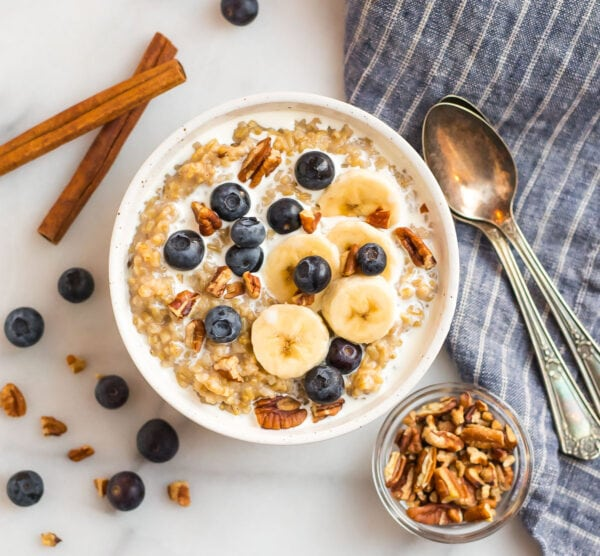 A bowl of easy and healthy oatmeal topped with fruit and nuts