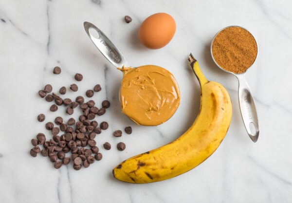 The ingredients for healthy peanut butter cookies with banana and chocolate chips