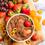 Healthy Chocolate Hummus in a bowl with pretzels and strawberries