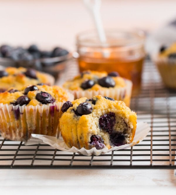 A wire rack with tasty blueberry coconut muffins for healthy snacks and breakfasts