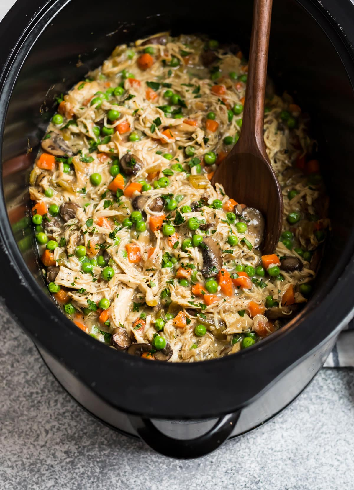 A creamy, hearty mixture of meat and veggies in a slow cooker