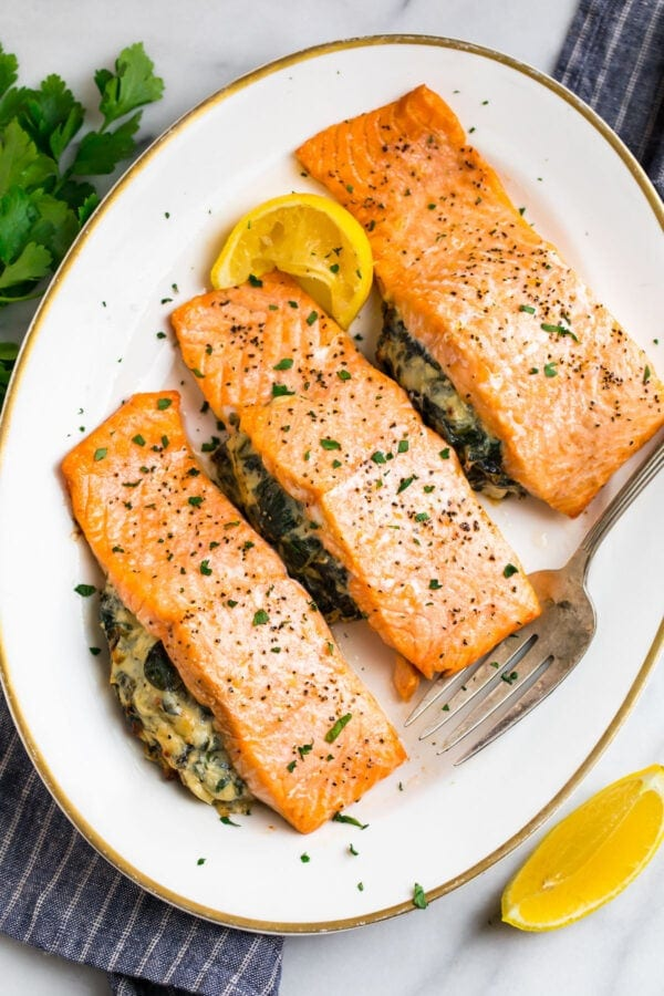 A platter with stuffed salmon with spinach and cream cheese