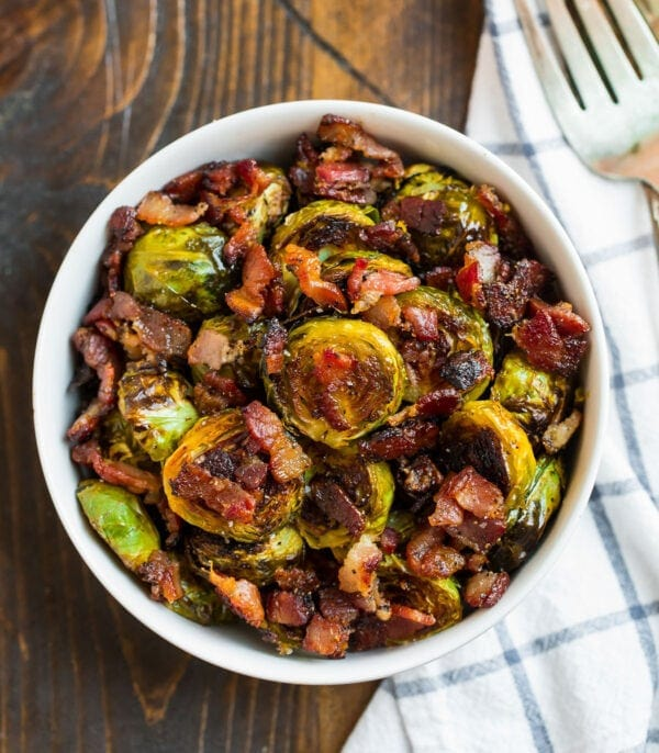 A bowl of oven roasted Brussels sprouts with bacon and maple syrup
