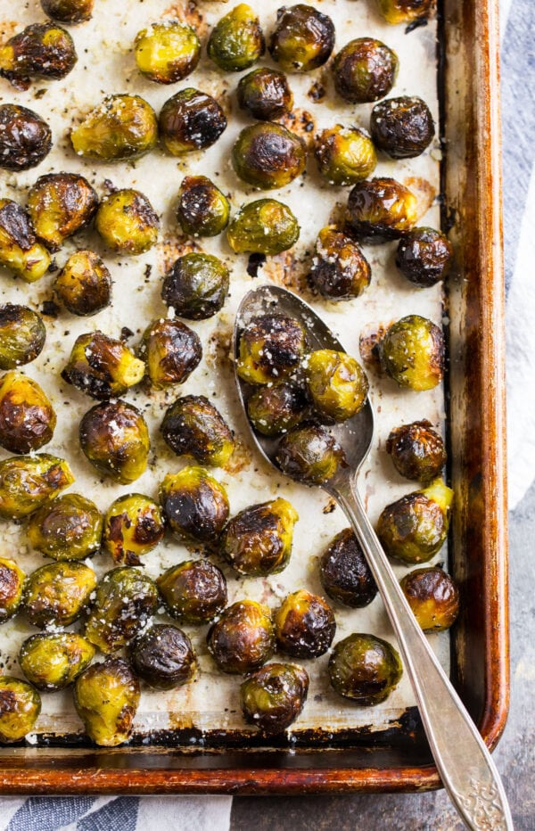 A baking sheet with delicious and easy roasted frozen Brussels sprouts