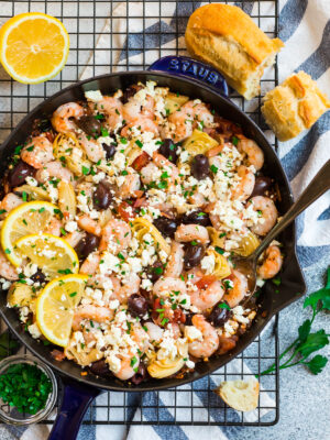A skillet with Mediterranean Shrimp with garlic and feta