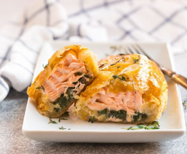 Easy salmon Wellington in puff pastry on a white plate