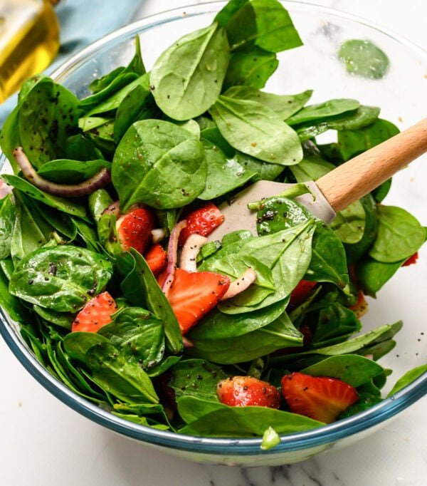 Strawberry spinach salad in a glass bowl