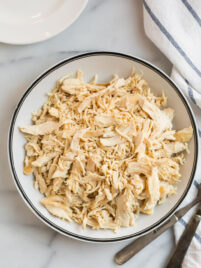 Easy crockpot shredded chicken on a white plate