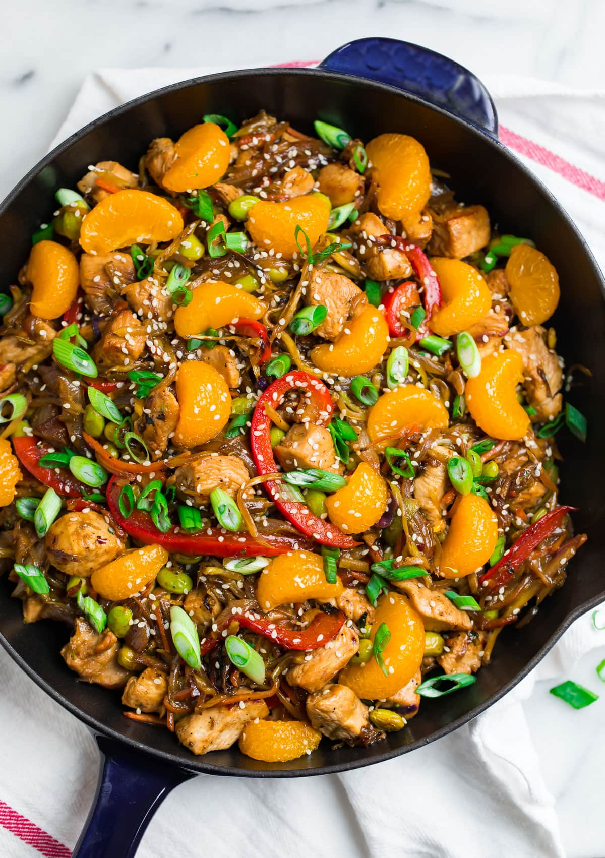 A healthy chicken stir fry with oranges