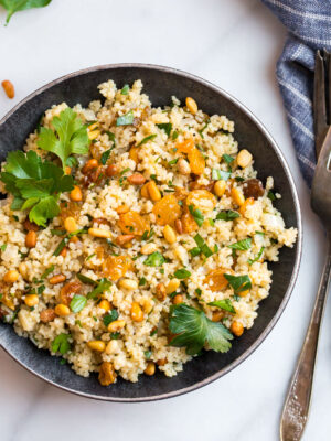 Moroccan couscous with raisins, spices, pine nuts, and fresh herbs