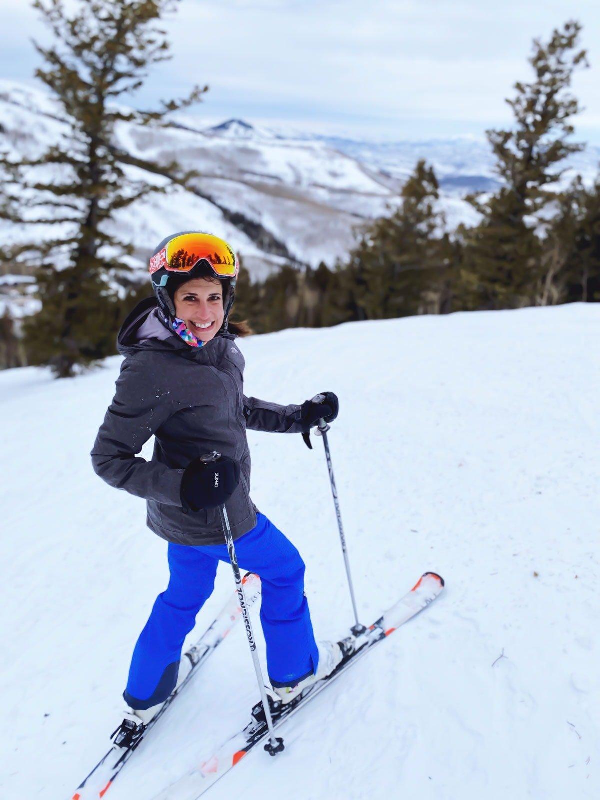 Girl in blue pants on skis at Deer Valley