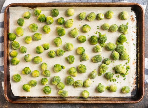 A baking sheet lined with parchment paper and full of vegetables