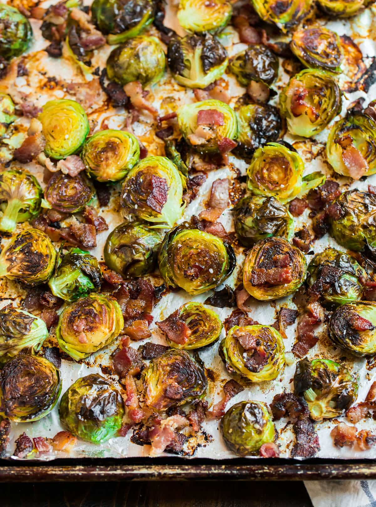 Crispy roasted vegetables on a baking sheet