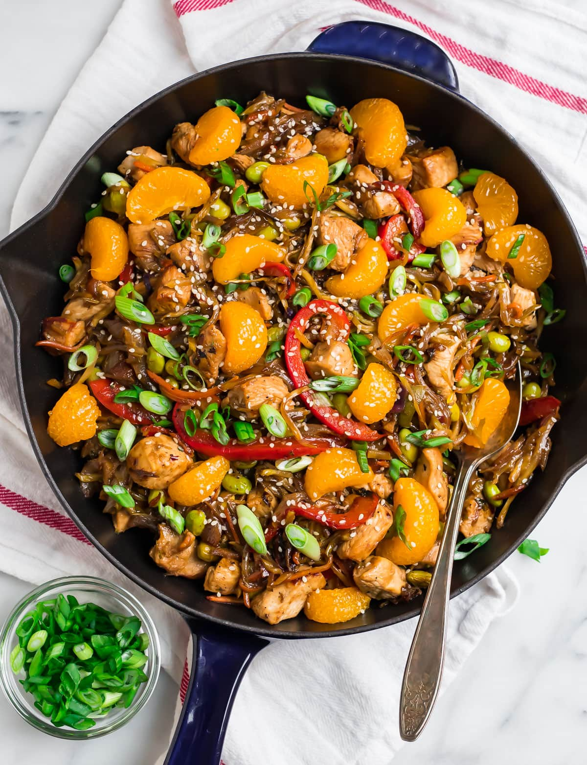 A pan of healthy chicken stir fry with Mandarin oranges