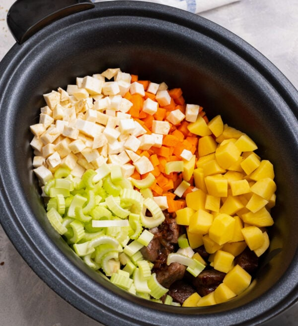 celery, carrots, potatoes, and parsnips for vegetable beef soup in a crockpot