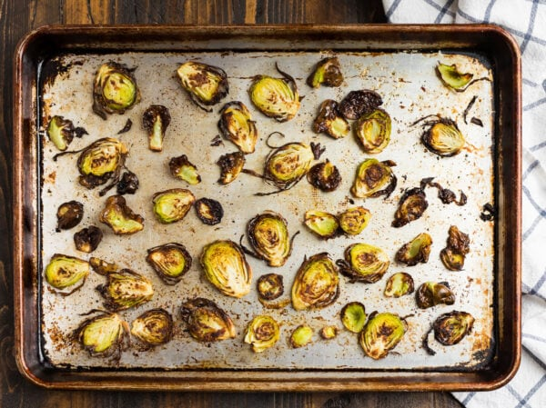 Sliced Brussels Sprouts Chips arranged on a sheet pan and baked until crispy
