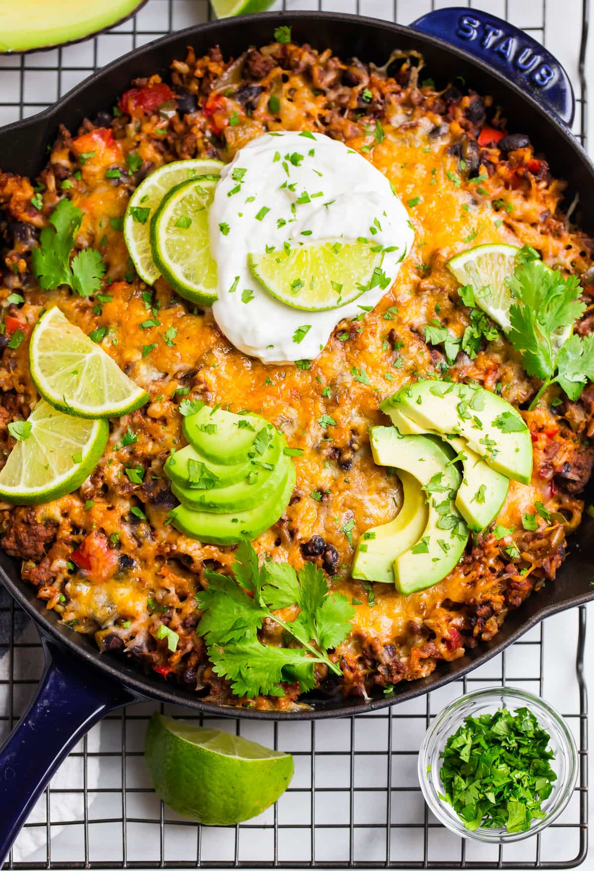 Healthy Beef Taco Skillet with Rice topped with avocado