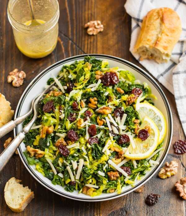 A green kale brussels sprouts salad in a bowl with a fork