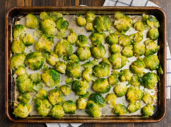A baking sheet with smashed vegetables