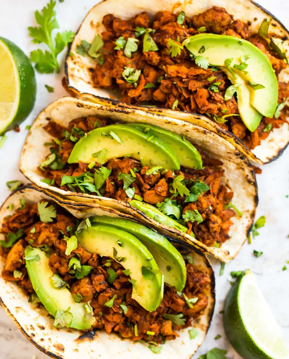 Tempeh tacos topped with avocado slices