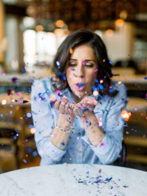 Erin Clarke in a Chambray Shirt Blowing Confetti