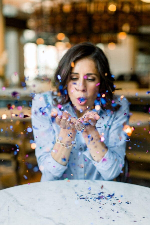 Erin Clarke in a Chambray Shirt Blowing Confetti