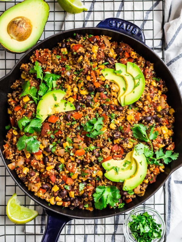 healthy Mexican quinoa in a skillet with avocado