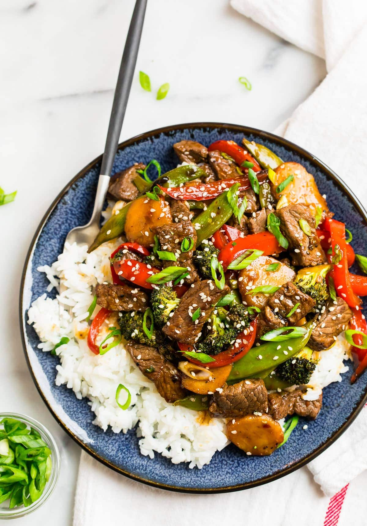 Teriyaki Beef Stir Fry topped with green onions