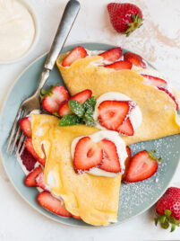 French strawberry crepes with cream filling on a plate