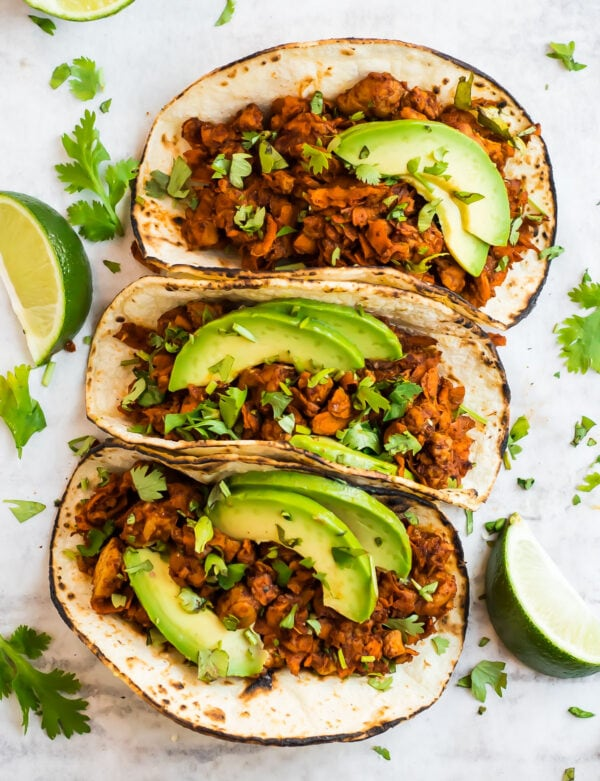 sweet potato tempeh tacos topped with avocado slices