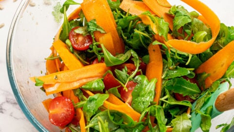 Arugula salad with shaved carrots and tomatoes