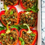 Vegan stuffed peppers in a white baking dish