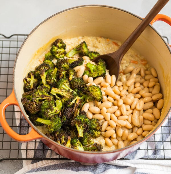 A Dutch oven with broccoli, beans, and quinoa