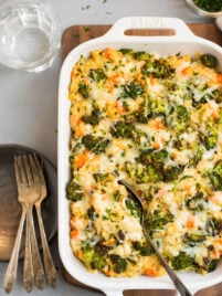 Cheesy broccoli quinoa casserole in a baking dish