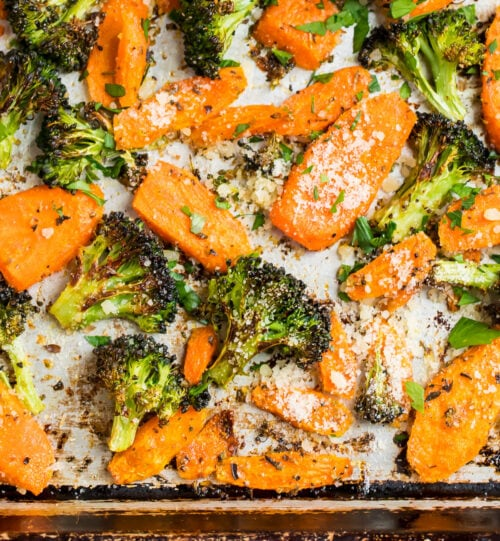 Easy Parmesan roasted carrots and broccoli on a baking sheet