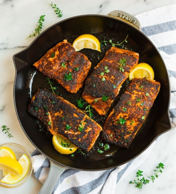 Four pieces of blackened salmon with lemon