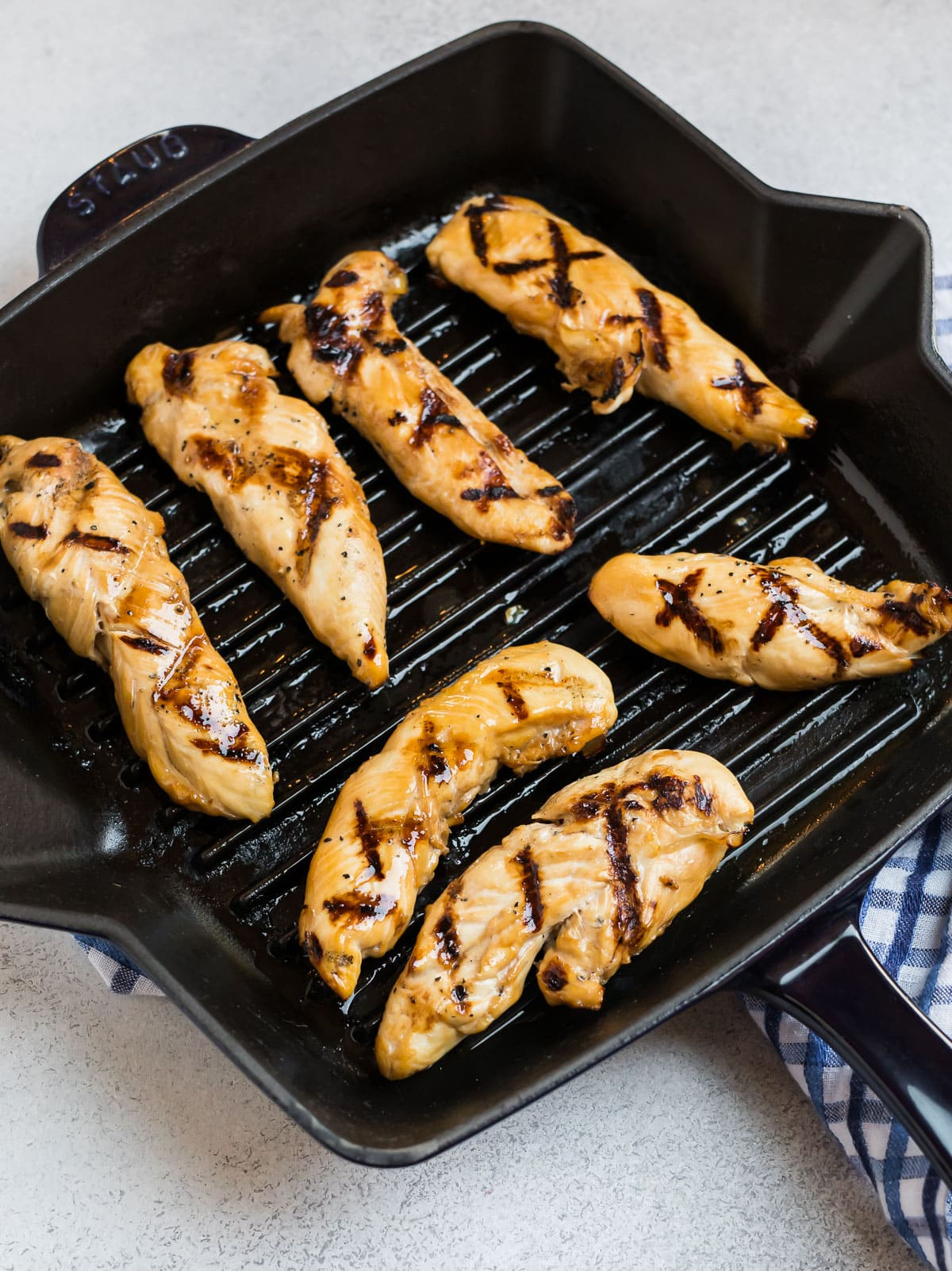 Grilled chicken tenders on a grill pan