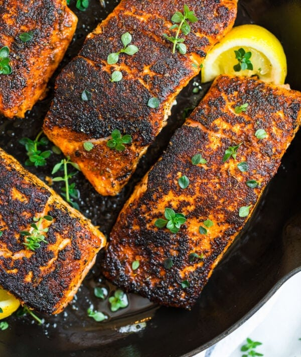 Easy blackened salmon in a skillet with lemon
