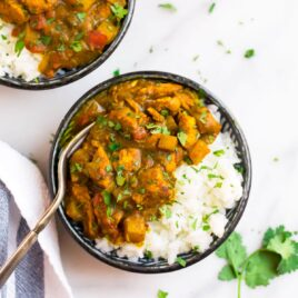 Jamaican curry chicken with rice in a bowl