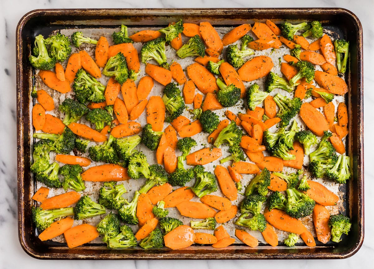 Broccoli and carrots on a baking sheet