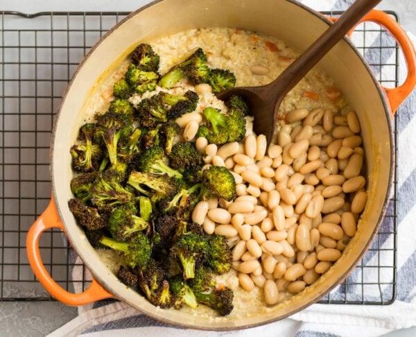 Beans, broccoli, and quinoa in a Dutch oven
