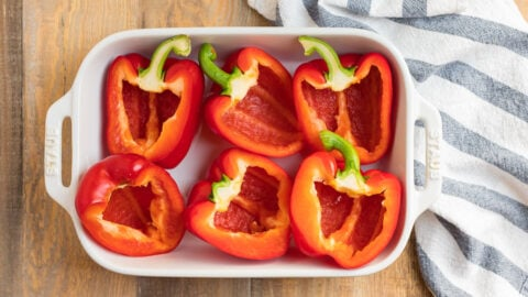 Red pepper halves in a baking dish