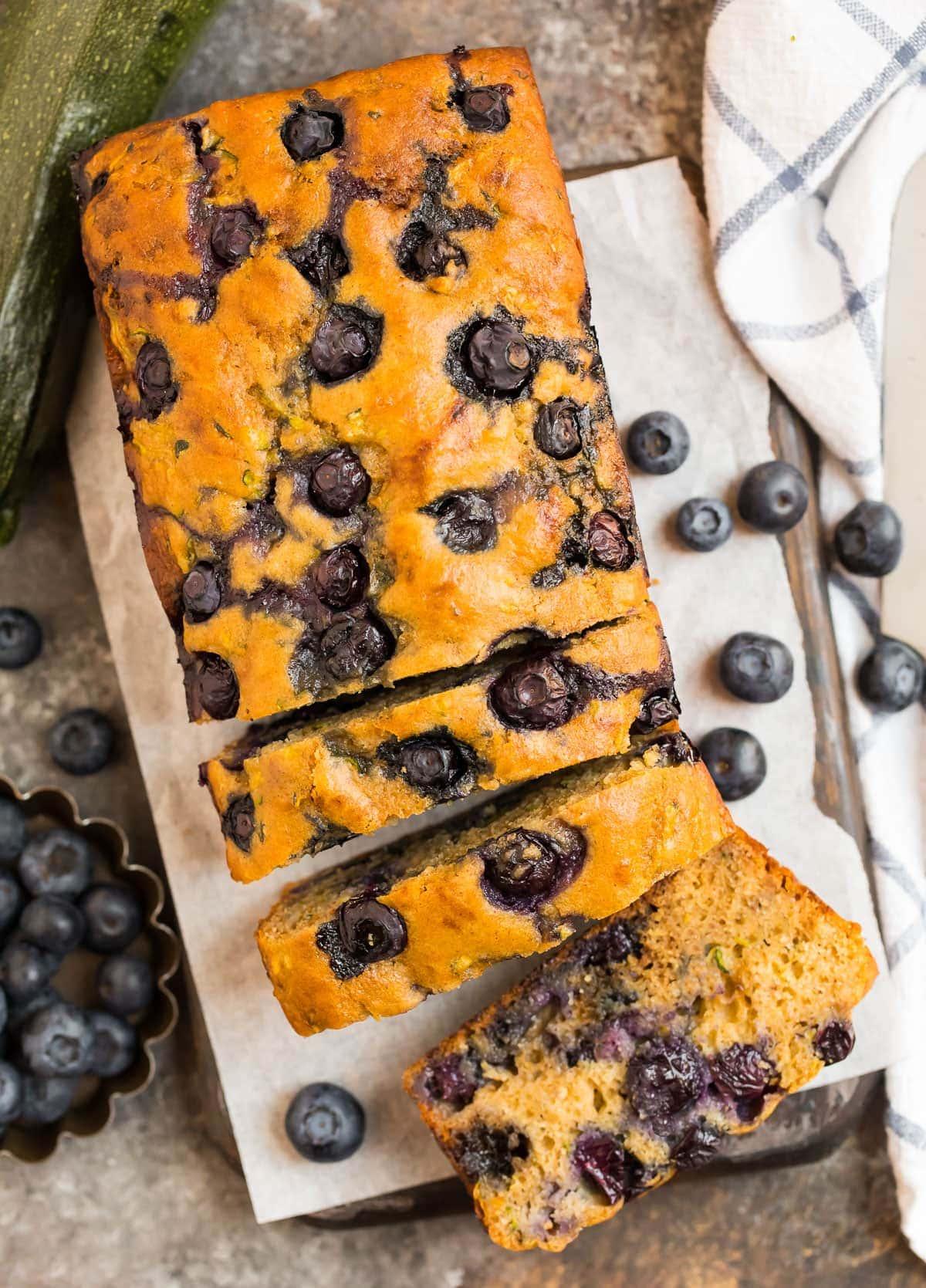 Easy blueberry zucchini bread cut into slices