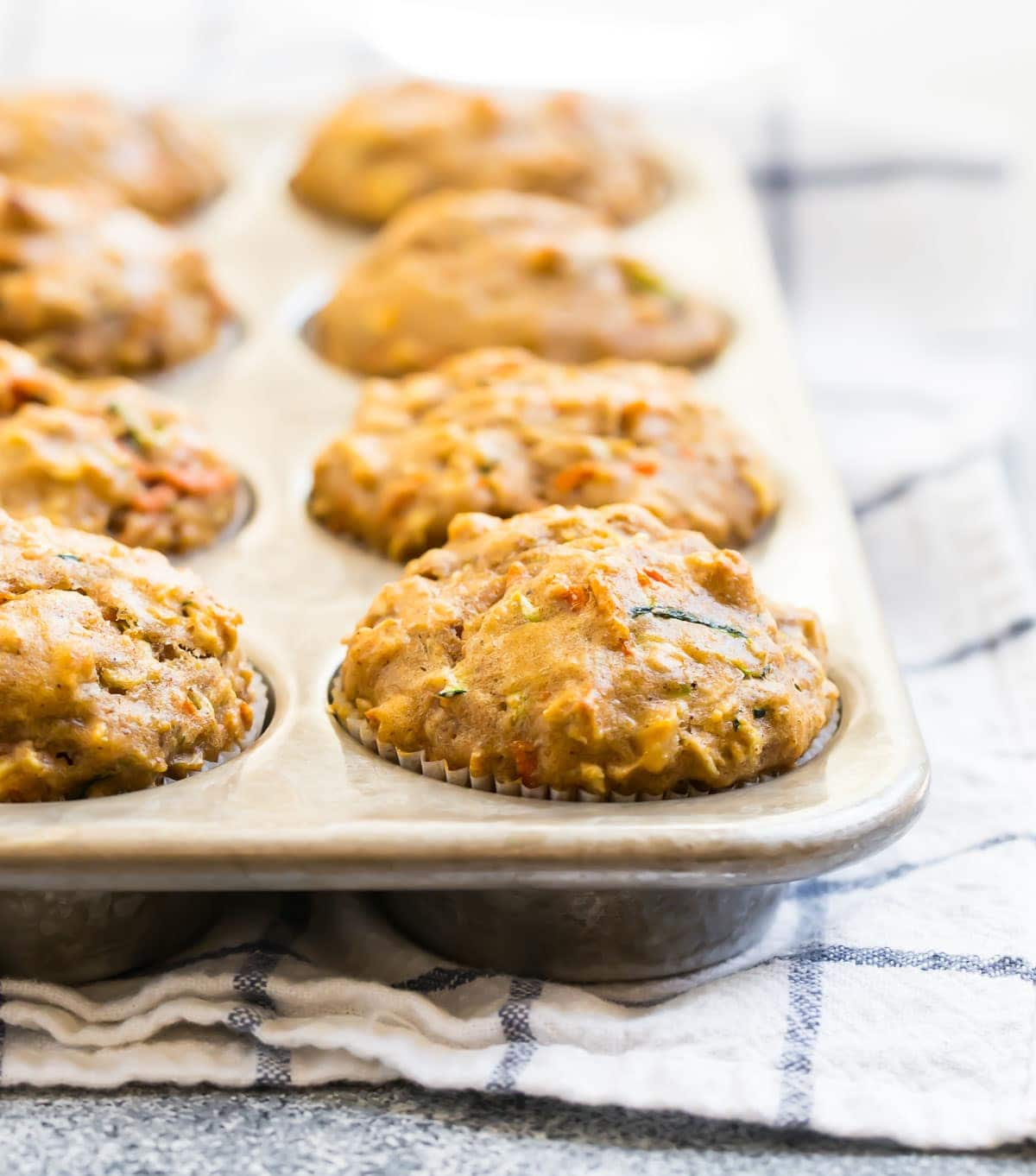 Zucchini carrot muffins in a muffin pan